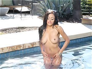 ultra-cute tiny ebony honey Anya Ivy frigging her cunt by the pool
