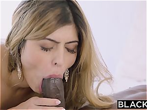 Arab nymph Audrey Charlize likes the taste of a big black cock