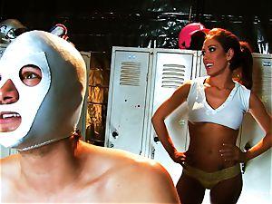 buxom black-haired Capri drills an aspiring luchador