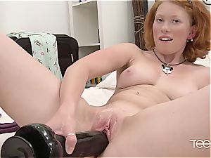 Ginger Russian plays with her fuckbox and takes a warm flow