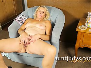 Mature honey Cristine Ruby paws a Lolli On Her beaver