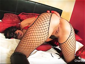 Dolled up Charley chase plays with her twat