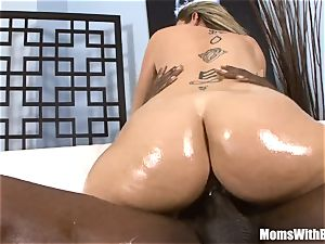 Oiled-Up blonde cougar Sara Jay romping dark-hued pipe