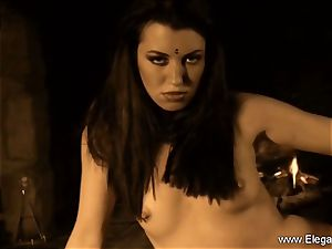 Serious black-haired nude allurement