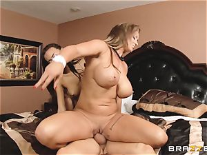 Eva Notty displays her stepdaughter Janice Griffith how to sate a rod